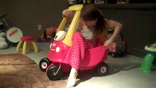 Mom tries to get in baby's toy car