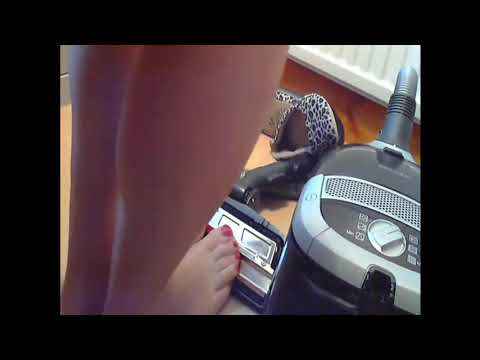 Vacuum cleaner is sucking woman's toes and thin nice socks. 1922712