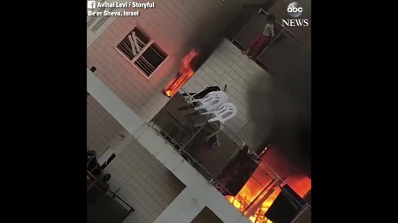 ABC News - Young girl jumps off balcony to escape fire