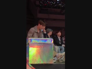 Jungkook telling fans not to push too much and even giving a water bottle to one of them,