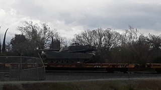 Us Military tanks being transported on train