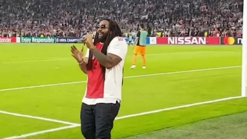 This is brilliant! Bob Marleys son, Ky-Mani Marley, sang Three Little Birds' at half time during the Ajax v AEK Athens game via