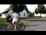 Blonde sexy Girl Samira rides her bicycle in a minidress without no panties