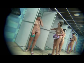 A hidden camera in a public shower films gorgeous women while they soap up