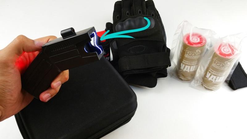 Посылка!!Стреляющий электрошокер Taser и Тактический набор.