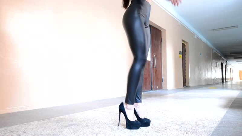 High heels walk. Girl in Leather Leggings