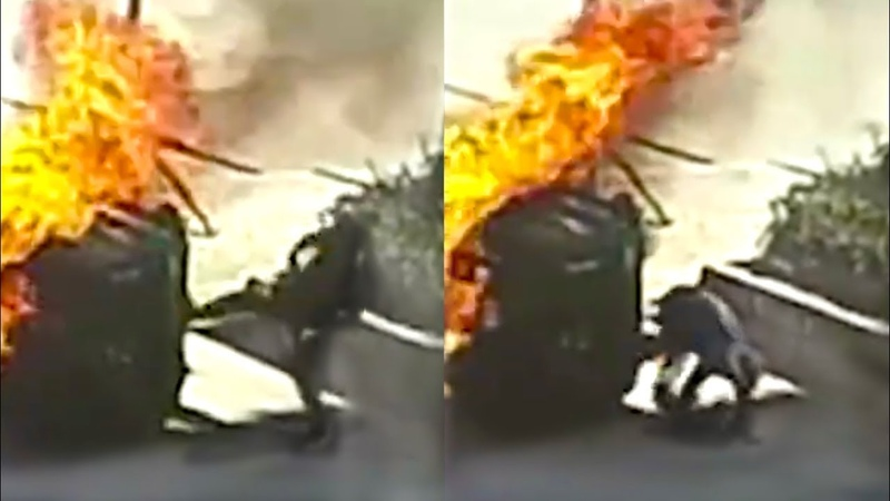Passerby kicks out windshield to rescue driver from vehicle fire