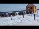 9 тракторов Беларусь перевозят с места на место готовый двухэтажный дом в дебрях Якутии.