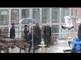 Laurence Fishburne and Mark Dacascos face off on a rainy rooftop building for