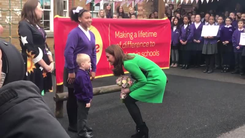 The DuchessofCambridge receives a posy from a child