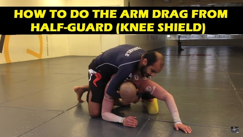 How To Do The Arm Drag From Half-Guard (Knee Shield) by Bernardo Faria