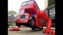 Double Decker Bus Doing Push ups in London by David Cerny Czech House