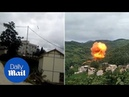 Rocket booster crashes down to earth and explodes near houses - Daily Mail