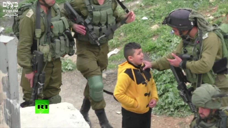 IDF grab 8yo Palestinian boy drag him away to find stone throwers