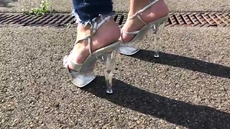 Clear high heels walking slow mo