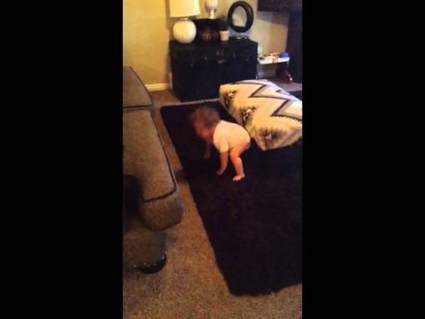 Baby falls off couch