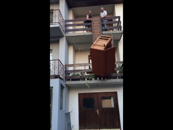 Movers Accidentally Drop Wardrobe off Balcony - 989808