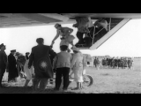 Several passengers helped out of airship LZ 129 Hindenburg as ground crew secures...HD Stock Footage