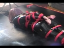 Strapped Gagged Vibed in Rubber Catsuit