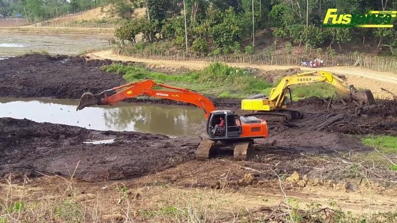 Hitachi Zaxis 210 Komatsu PC200 excavators move peat soils to shelters