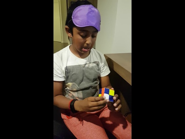 Aryan solving a Rubik's cube blindfolded in 22 seconds
