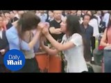 Moment FURIOUS wife scolds husband's mistress in public - Daily Mail
