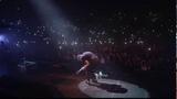 Damon Albarn sneezing on stage