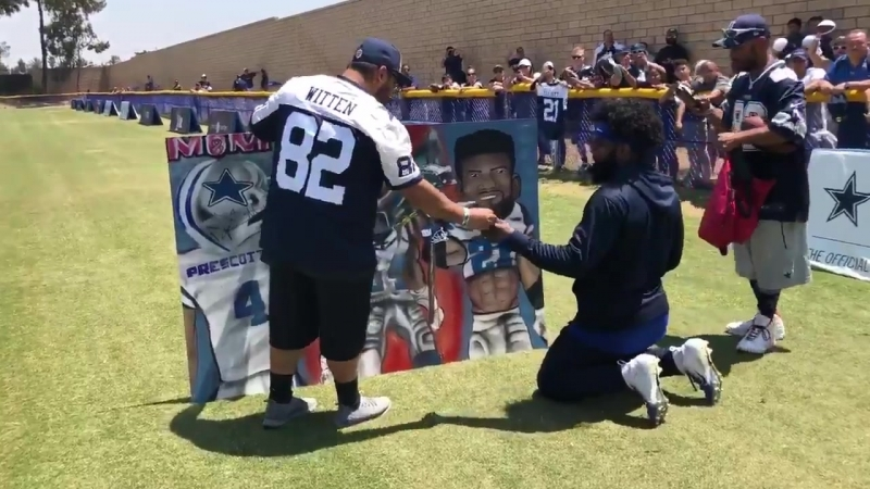 Zeke and Dak sign fan banner CowboysCamp Day 11
