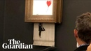 Banksy artwork self destructs after selling at auction for £1m
