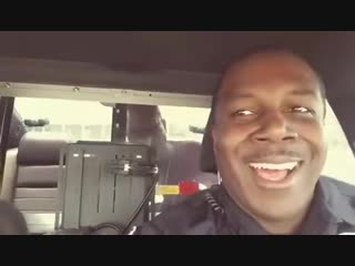 Cool policeman transports a happy prisoner