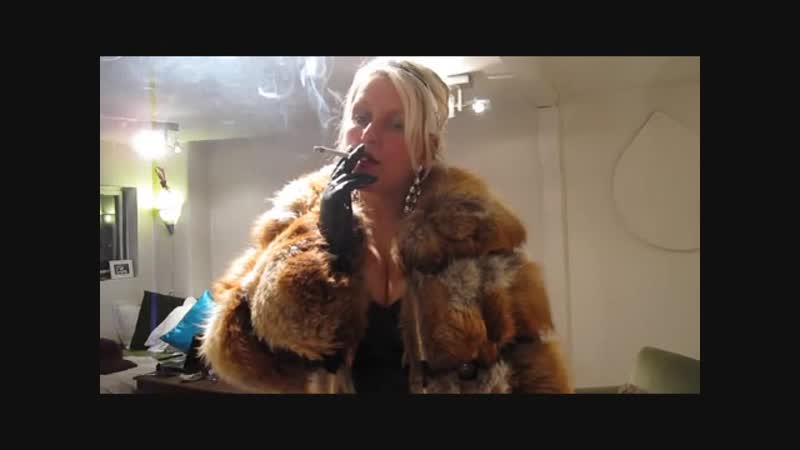 Miss Sina in fur and gloves smoking an all-white cigarette