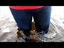 Girl in wet jeans, a red turtleneck and boots in deep water (1) MOV 0234 27062018