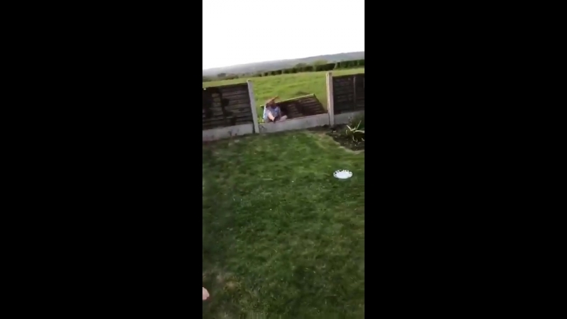 Lad smashes through garden fence