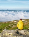 The ocean of clouds overflows in a mountain valley. Location place Ukrainian Carpathians