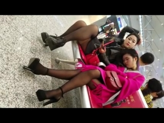 Candid black pantyhose and heels two asian girls