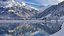 Картинка зима. Лес, горы, городок, снег, деревья, озеро, дома.