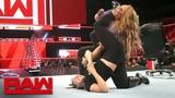 Ronda Rousey traps Nia Jax in an armbar Raw, June 11, 2018