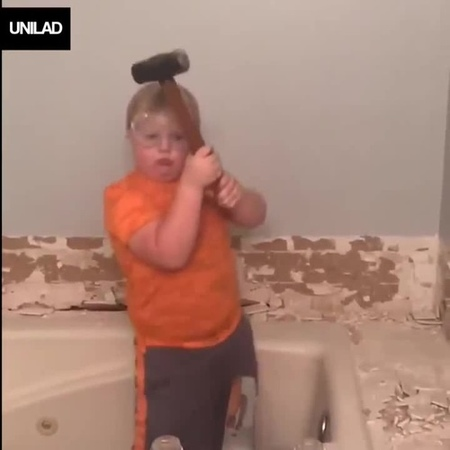 Kid Dancing With Hammer