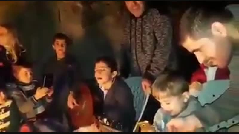 Mohammed Mahmoud December 30, 2018 at 8:33 PM Palestinian children in a campfire in the Gaza Strip, sing and laugh