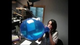 How quick can she blow the balloon until it pops game at radio station