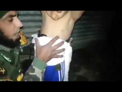 Iraqi soldier removes suicide belt from boy in Mosul (with English subtitles)