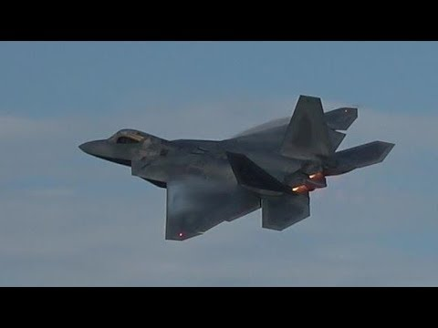 F-22 Raptors blitz Oshkosh runway with afterburners