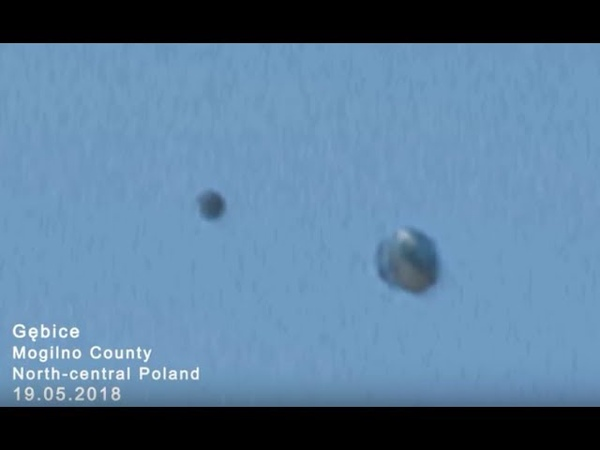 SPHERE SHAPED UFOS MERGE OVER GEBICE, NORTHERN POLAND ON 05/19/2018