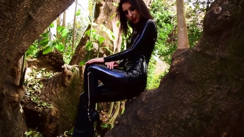 Wearing a Black Latex Catsuit and High Heel Boots in the Park В латексе по порку femdom fetish bdsm фемдом бдсм