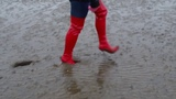 Jana goes to mud flat with her shiny red high heel overknee boots