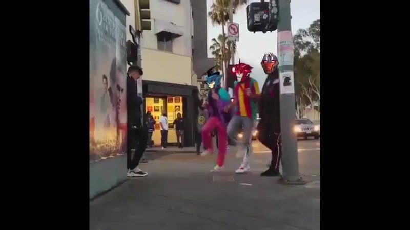 Two speedsters and a hunk walk out of a bar