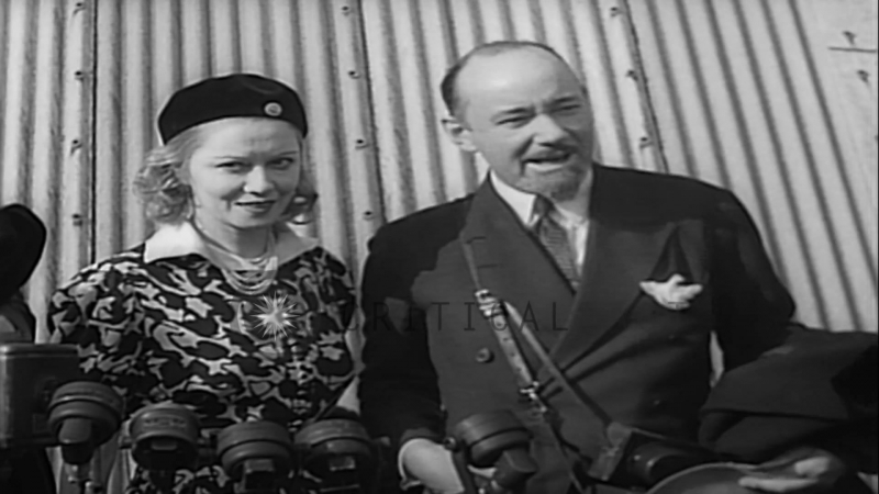 Sir Hubert and Lady Wilkins are interviewed upon arrival in the U.S. aboard the G...HD Stock Footage