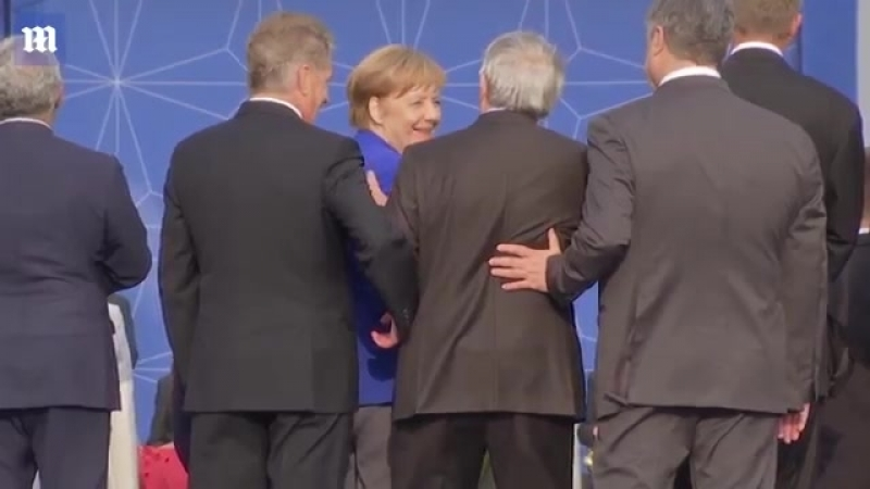 Jean-Claude Juncker stumbles and is helped by leaders at NAT