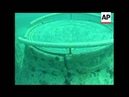 About forty five feet beneath the ocean's surface lies a cemetery with gates pathways plaques and