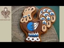 Cookie decorating with royal icing. Royal icing wet on wet technique. Rooster shaped cookie